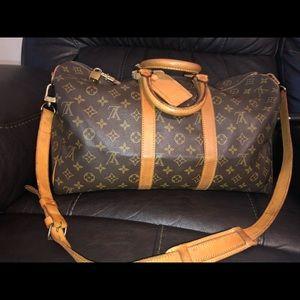 Authentic Louis Vuitton Keepall 45 Bando!